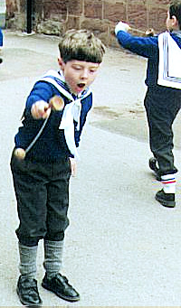 Boy with Cup & Ball Toss Toy