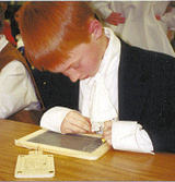 Boy with Slate and Hornbook